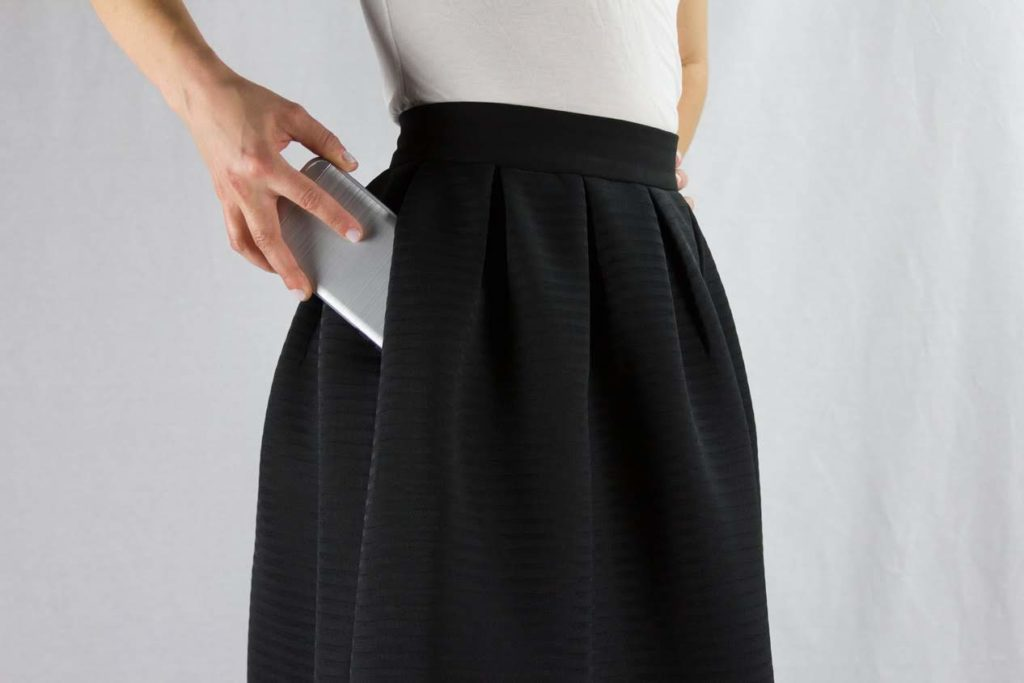 Black midi skirt with phone in pocket